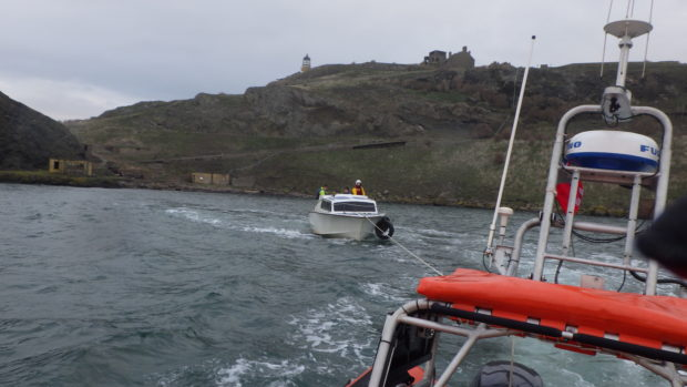 The boat being towed in to safety