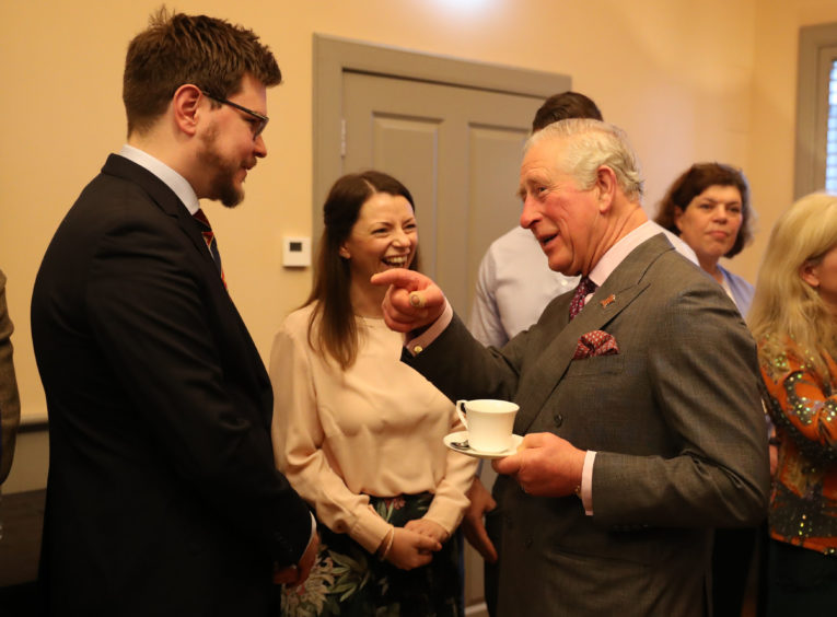 Prince Charles chats before unveiling a plaque to officially open The Dumfries House Health and Wellbeing Centre in Cumnock.