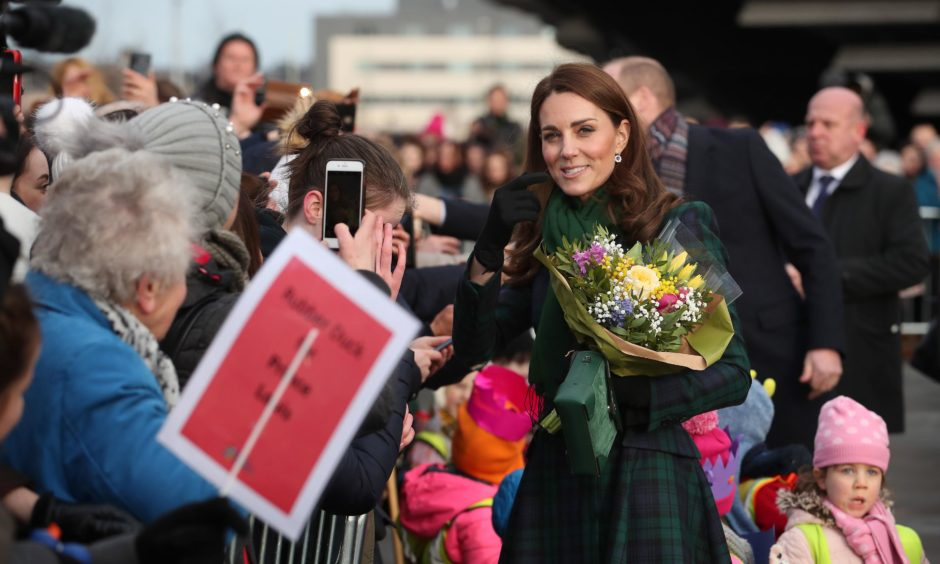 Kate greets members of the public on the waterfront during a walkabout. Jane Barlow/PA Wire