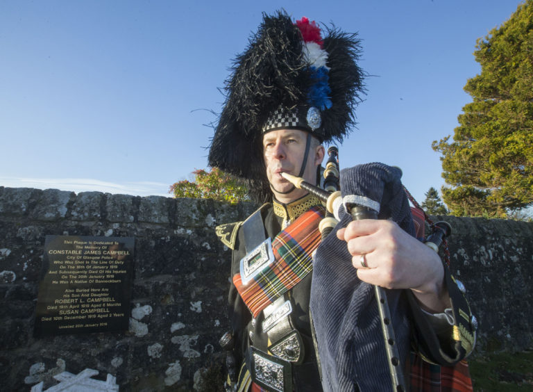 Pipe Sergeant Duncan Nicholson playing at Bannockburn Cemetery in Stirling during a ceremony to mark the 100th anniversary of the death of PC James Campbell, who was killed in the line of duty.