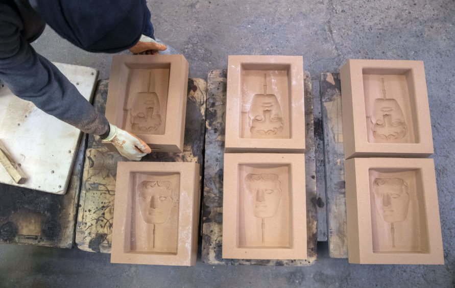 Sand casts are prepared during the hand-made casting of the British Academy of Film and Television Awards (BAFTA) masks.
