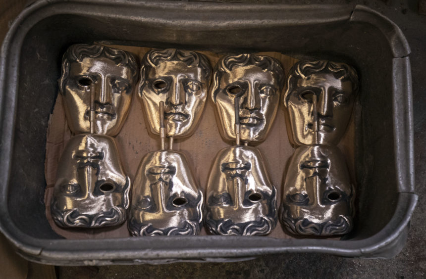 Finished masks wait to be collected during the hand-made casting of the British Academy of Film and Television Awards (BAFTA) masks.