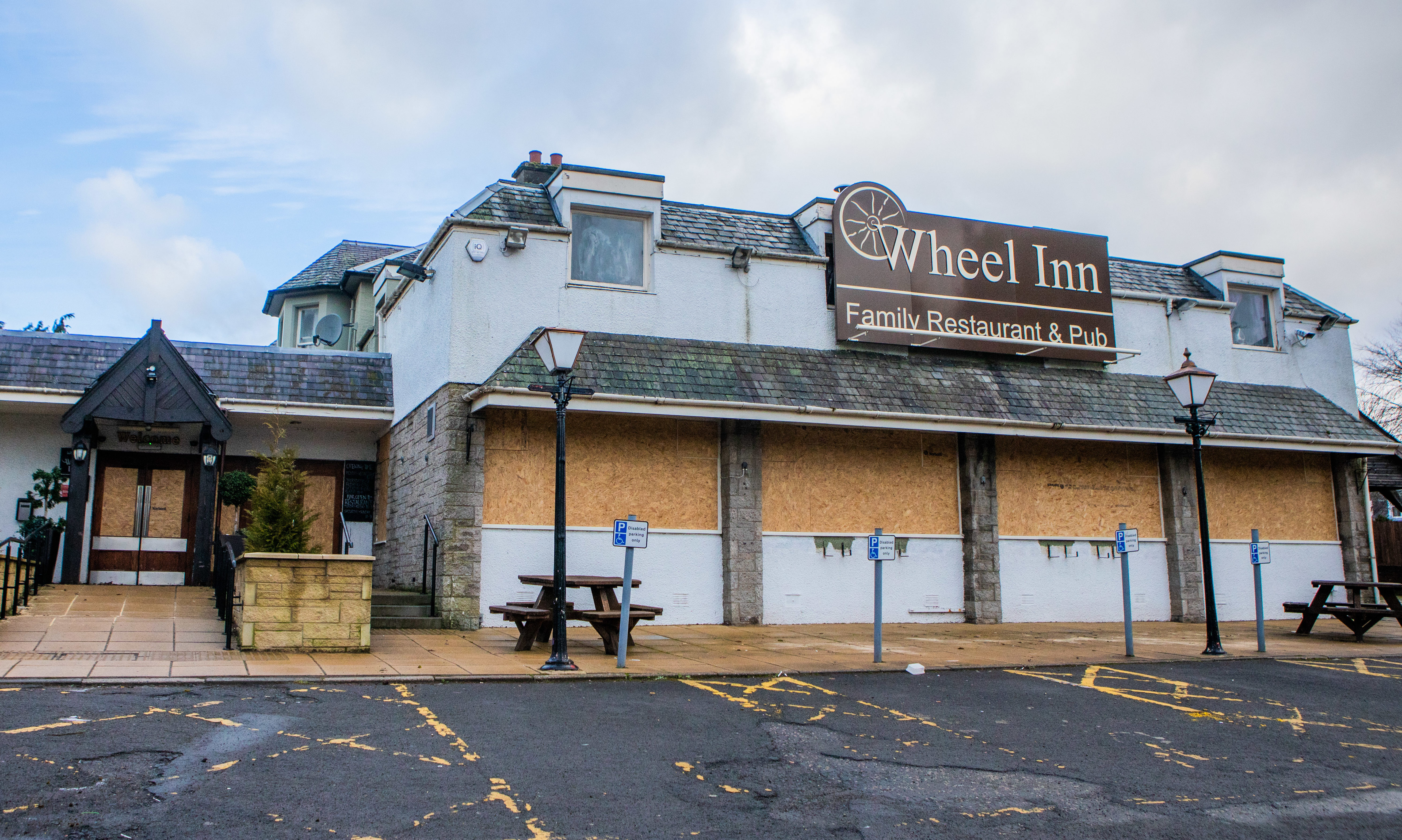 The Wheel Inn, Scone, all boarded up.