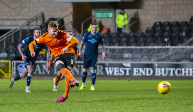 Fraser Fyvie slots away his penalty.