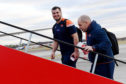 Edinburgh's head coach Richard Cockerill and Stuart McInally board the plane to travel to Toulon.