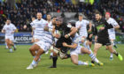 Tim Swinson leads the charge for Glasgow against the Blues.