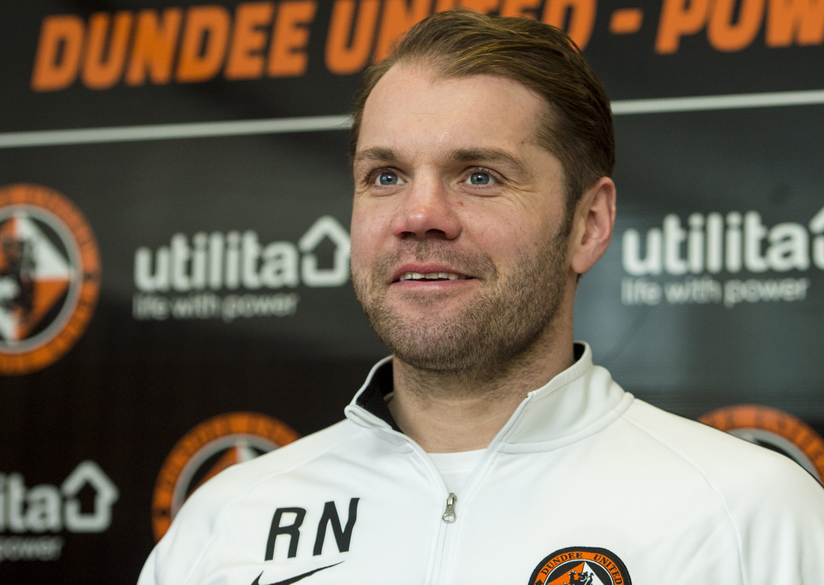 Robbie Neilson chats to the media at St Andrews.
