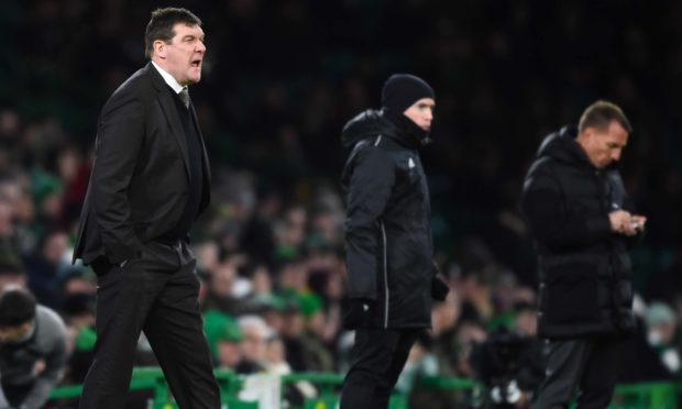 Tommy Wright shouts orders to his players at Celtic Park.