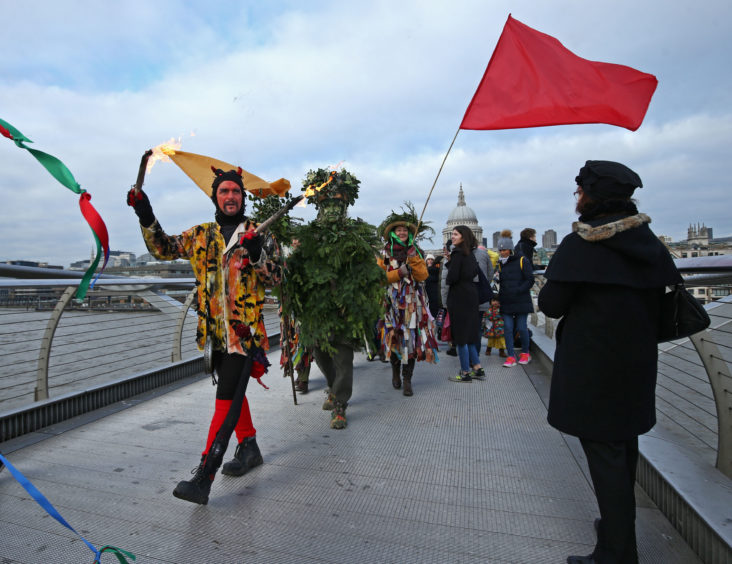 The 'Lions part' performers on Millennium Bridge during the annual Twelfth Night celebrations on the South Bank in central London.