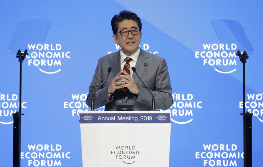 Japanese Prime Minister Shinzo Abe addresses the annual meeting of the World Economic Forum.