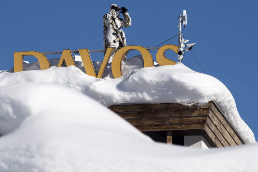 Member of Swiss special police forces stand on the roof of the Kongress Hotel next to the Congress Center.