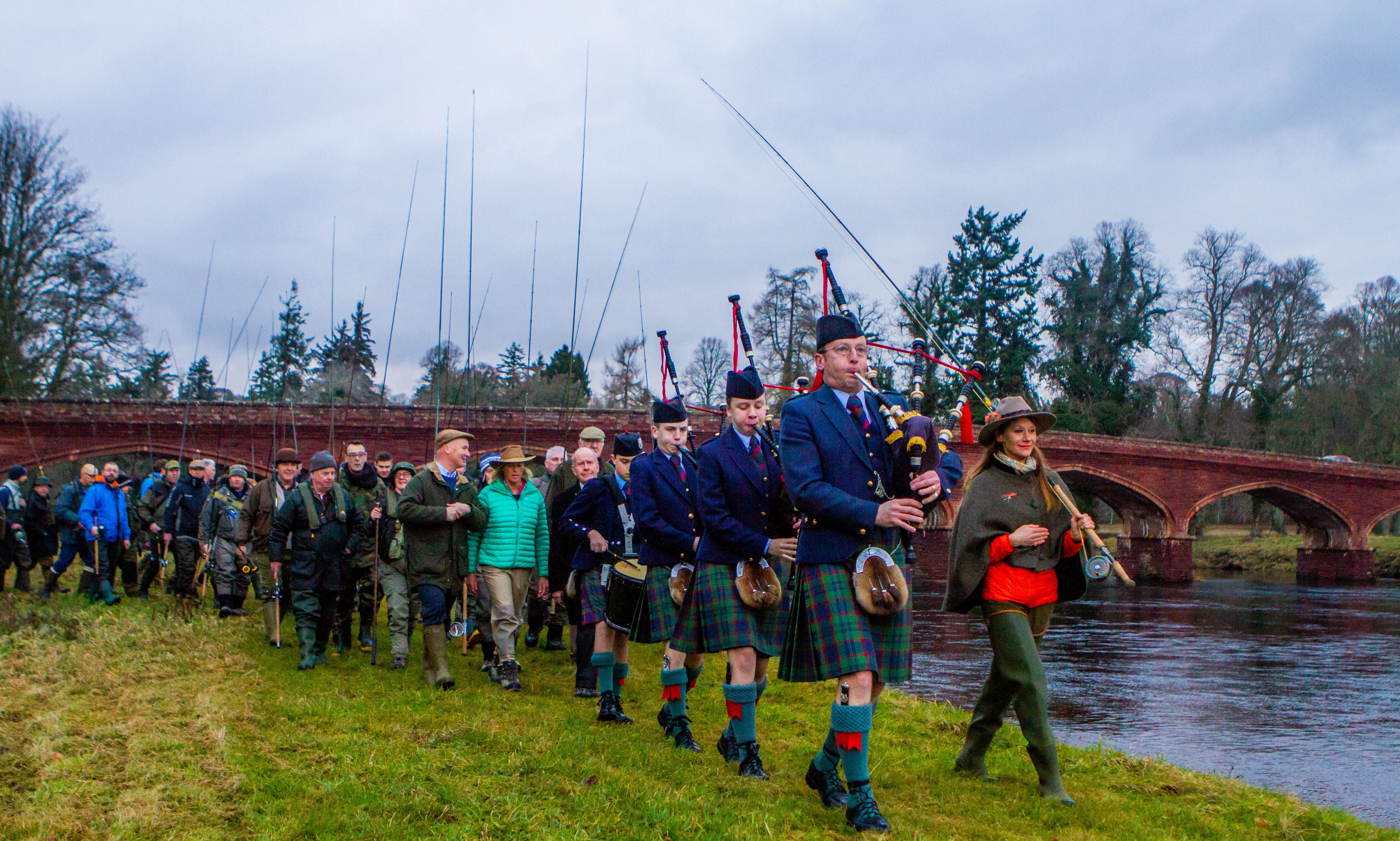 The parade before the opening led by Perth and District pipe band Pipe Major Alistair Duthie and Claire Mercer Nairne (of Meikleour Fishing). Meikleour Fishing, Kinclaven Bridge, by Meikleour.