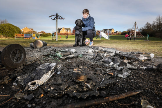 Fraser Burnett, 17 with his Lab Millie at the damaged area in Sandy Park.