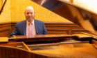 Balbirnie Hotel owner Nicholas Russell with the Baby Grand Piano.