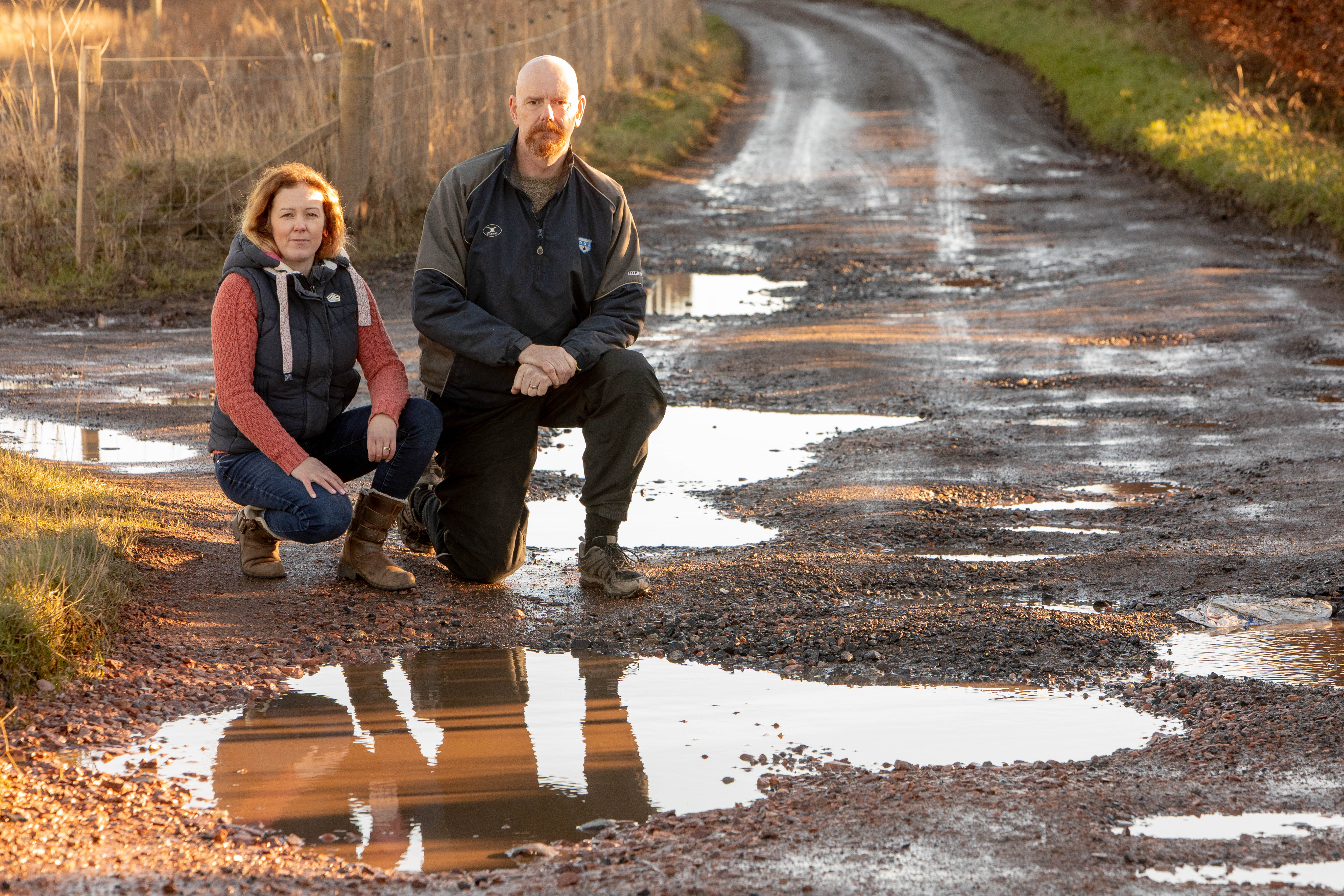 Laura Mysak and Alastair Stewart are looking for help from Fife Council to repair the potholed road they believe has been made worse by developments