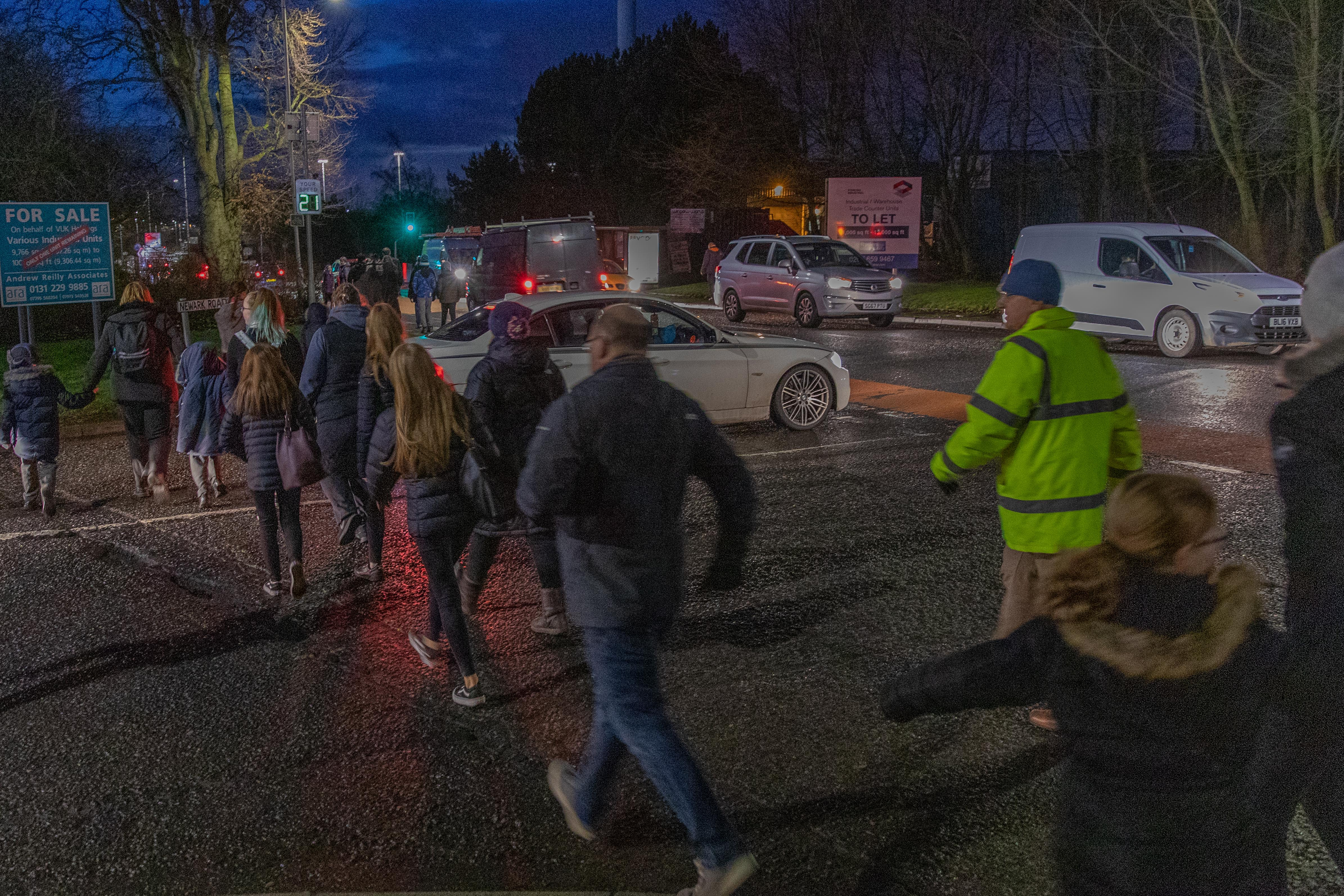 Parents and their children walk the proposed route that Fife Council state their children will need to walk to school once the bus service is terminated if plans go ahead.