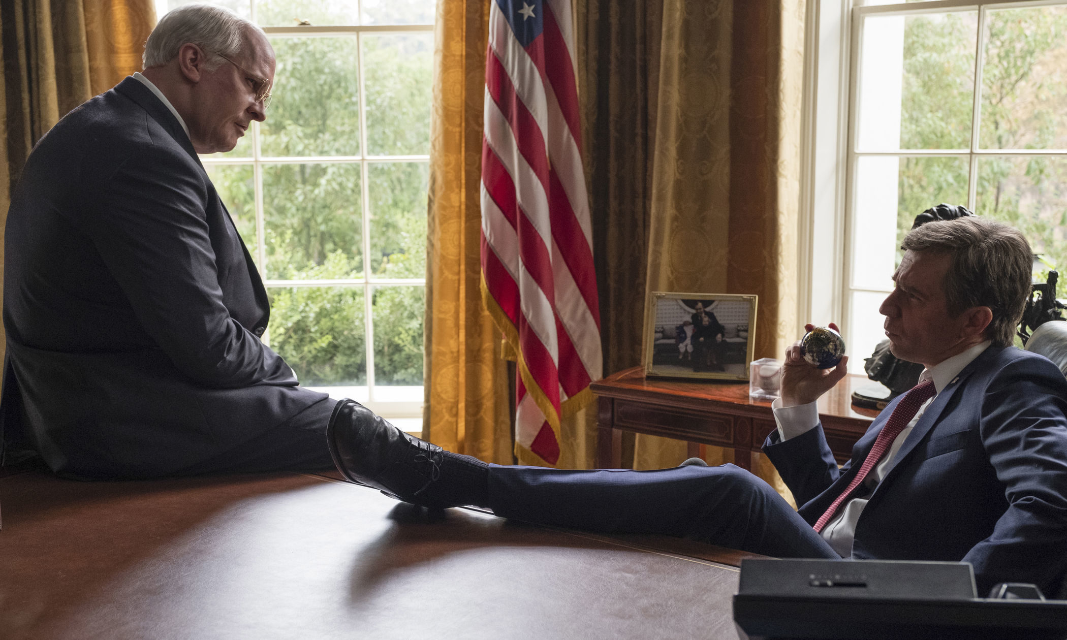 "This image released by Annapurna Pictures shows Christian Bale as Dick Cheney, left, and Sam Rockwell as George W. Bush in a scene from ""Vice."""