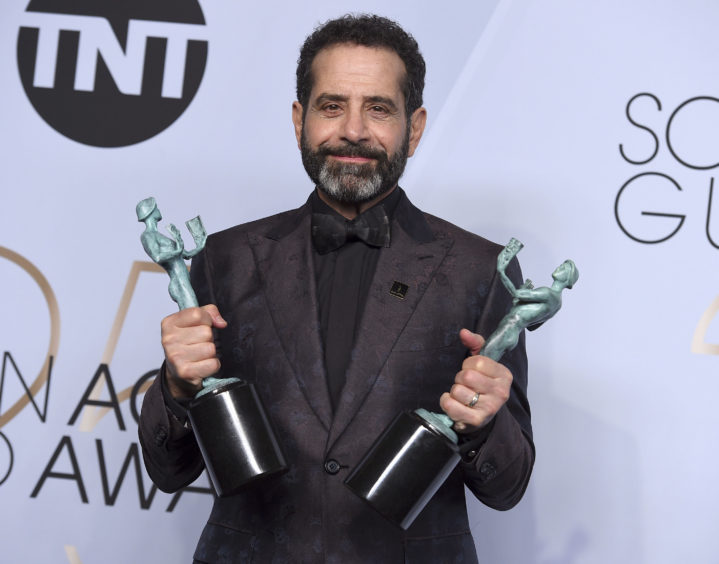 Tony Shalhoub poses with the awards for Outstanding Performance by a Male Actor in a Comedy Series for The Marvelous Mrs. Maisel and for Outstanding Performance by an Ensemble in a Comedy Series.