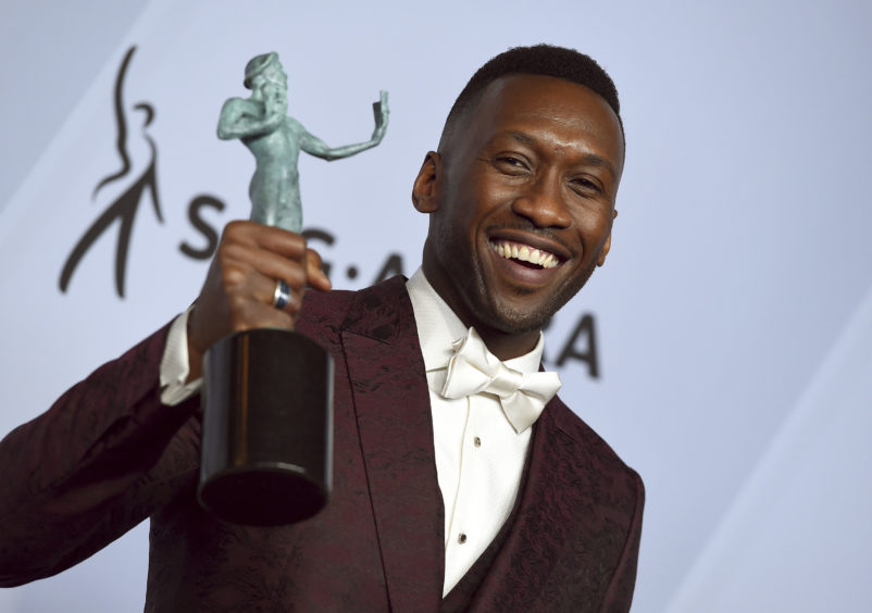 Mahershala Ali with his award for Outstanding Performance by a Male Actor in a Supporting Role for Green Book.