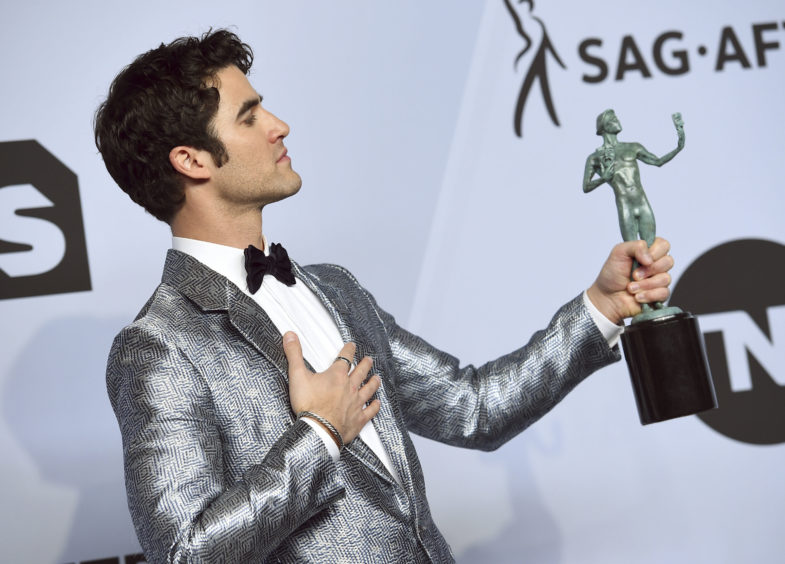Darren Criss poses with the award for Outstanding Performance by a Male Actor in a Television Movie or Limited Series for Assassination of Gianni Versace.