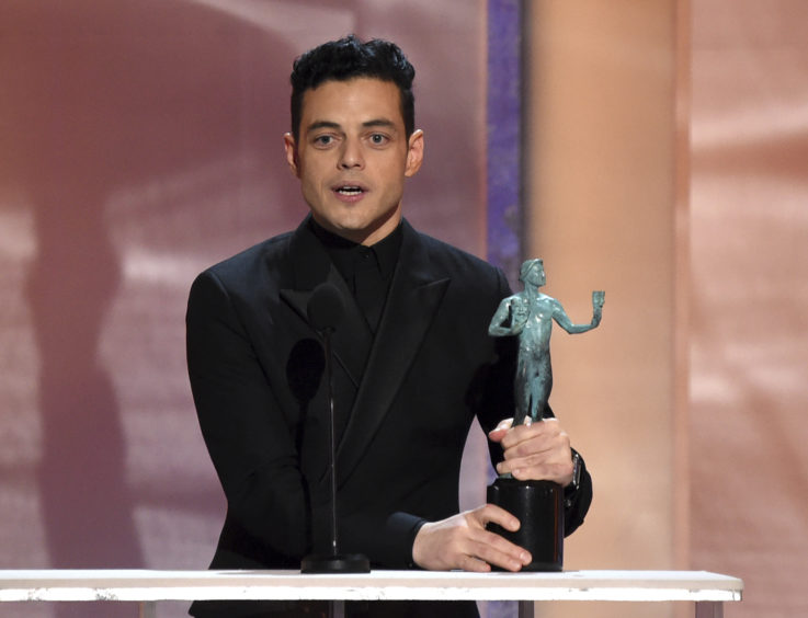 Rami Malek accepts the award for Outstanding Performance by a Male Actor in a Leading Role for Bohemian Rhapsody.