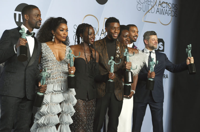 Sterling K. Brown, from left, Angela Bassett, Lupita Nyong'o, Chadwick Boseman, Danai Gurira, Michael B. Jordan, and Andy Serkis pose with the award for Outstanding Performance by a Cast in a Motion Picture for Black Panther.