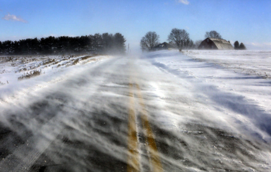 Drifting snow obscures a road near Mount Joy in Lancaster County. A bitter deep freeze is moving into the Northeast from the Midwest, sending temperatures plummeting and making road conditions dangerous.