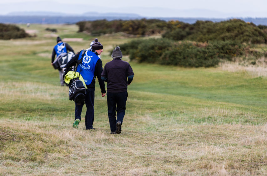 Caddie Simon Blackmore (44) with his golfer Henry McTaggart (76) from Dundee