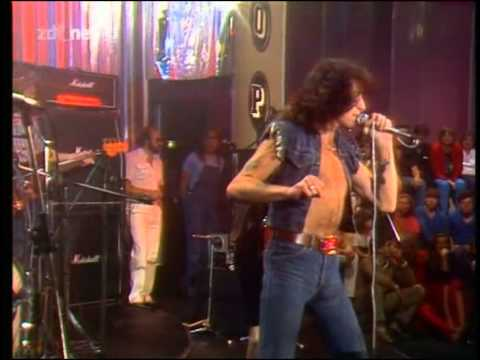 Bon Scott on stage with AC/DC in his glory days.