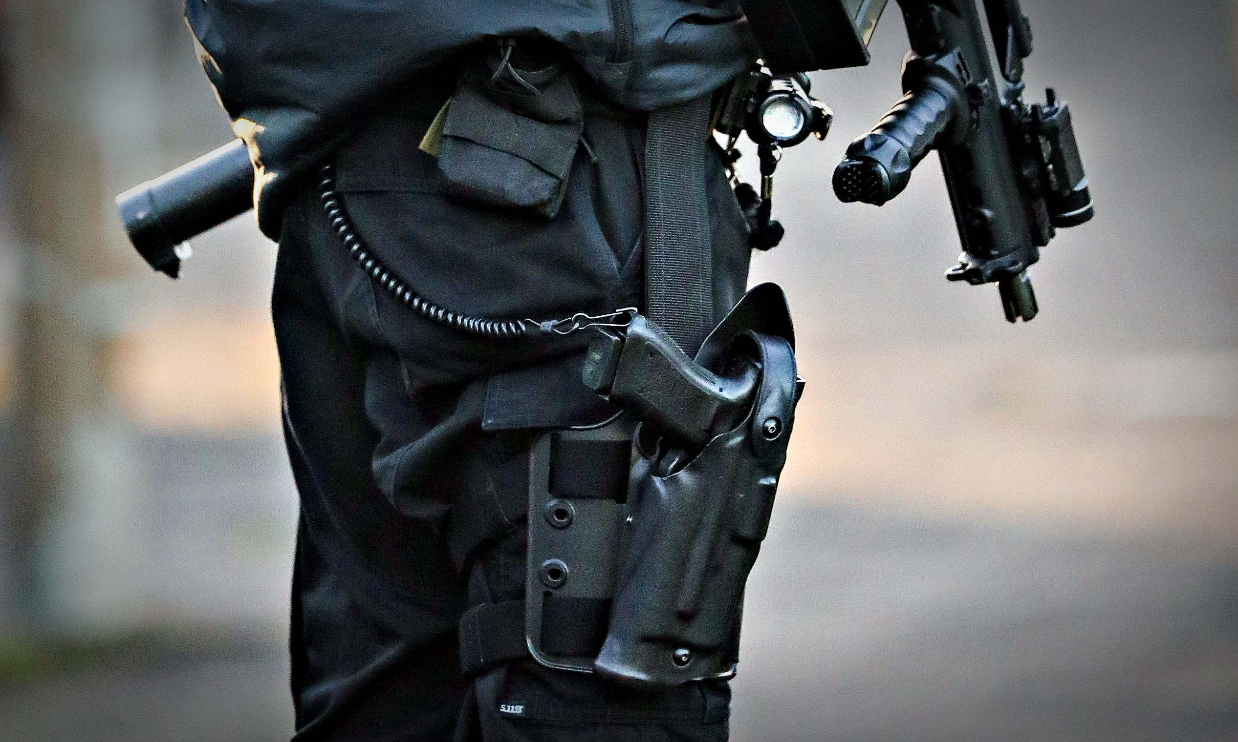 An armed police officer.