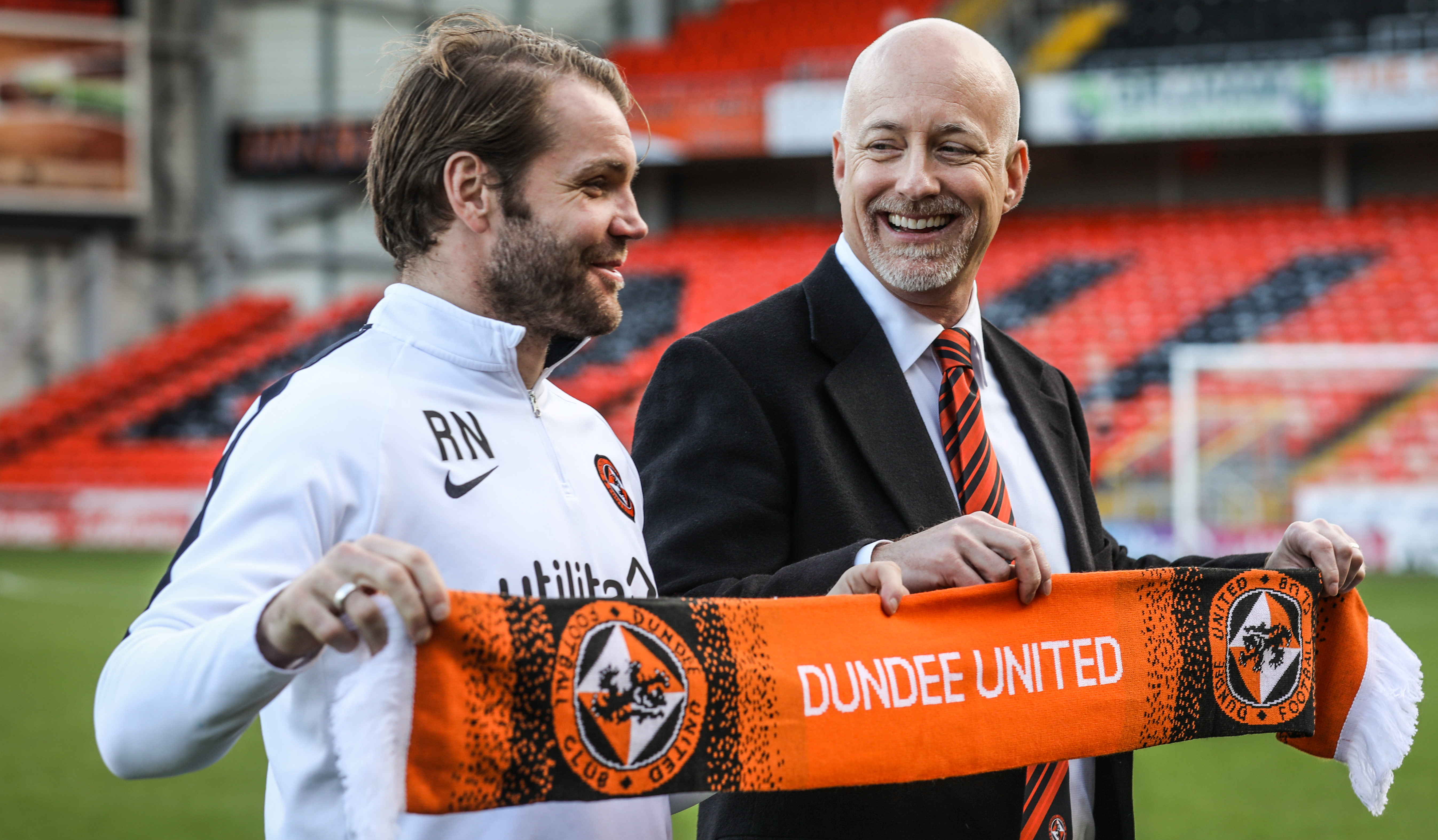 Mark Ogren, right, with manager Robbie Neilson.
