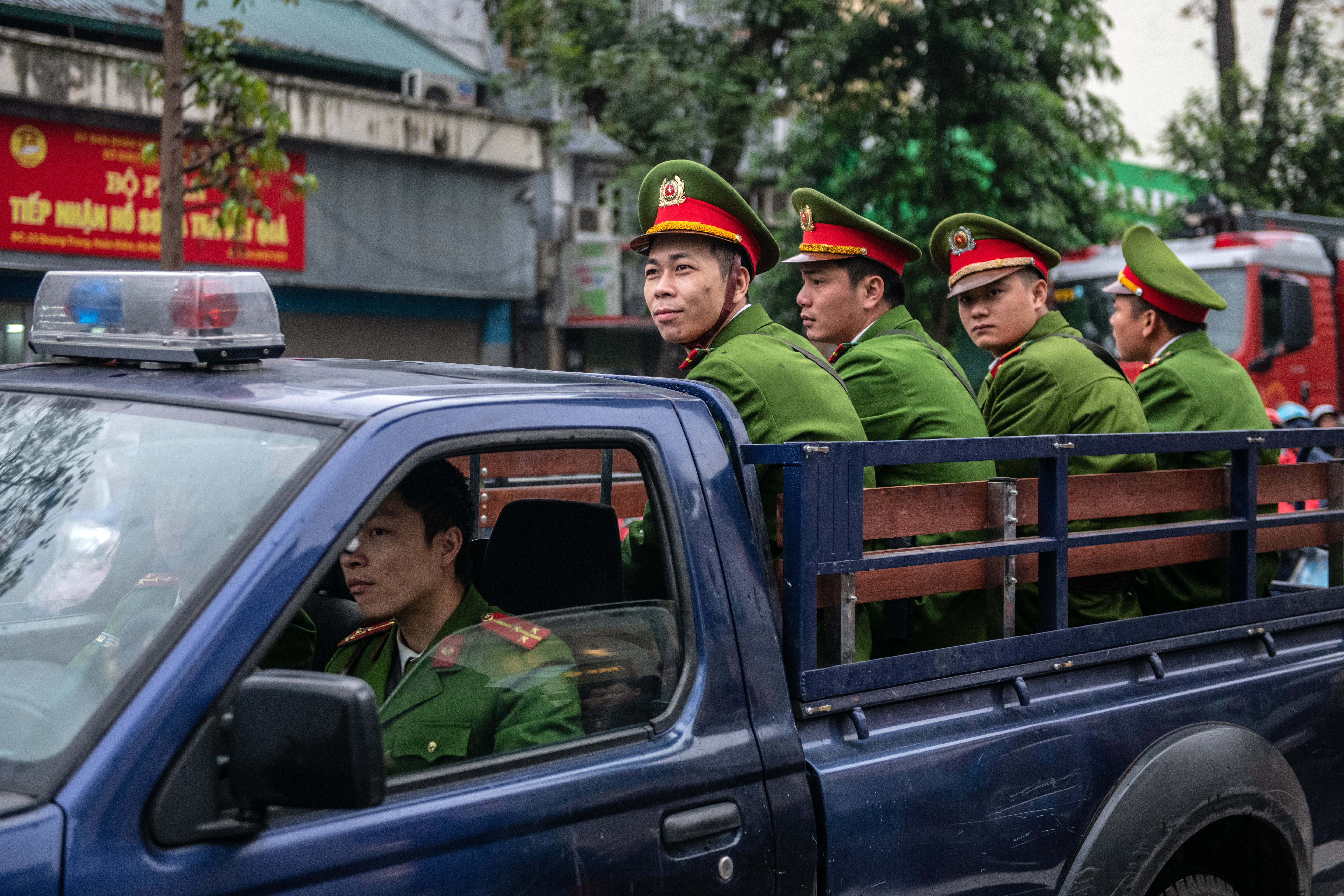 Police officers arrive to guard roads near the Melia Hotel before the arrival of North Korea's leader Kim Jong-un.