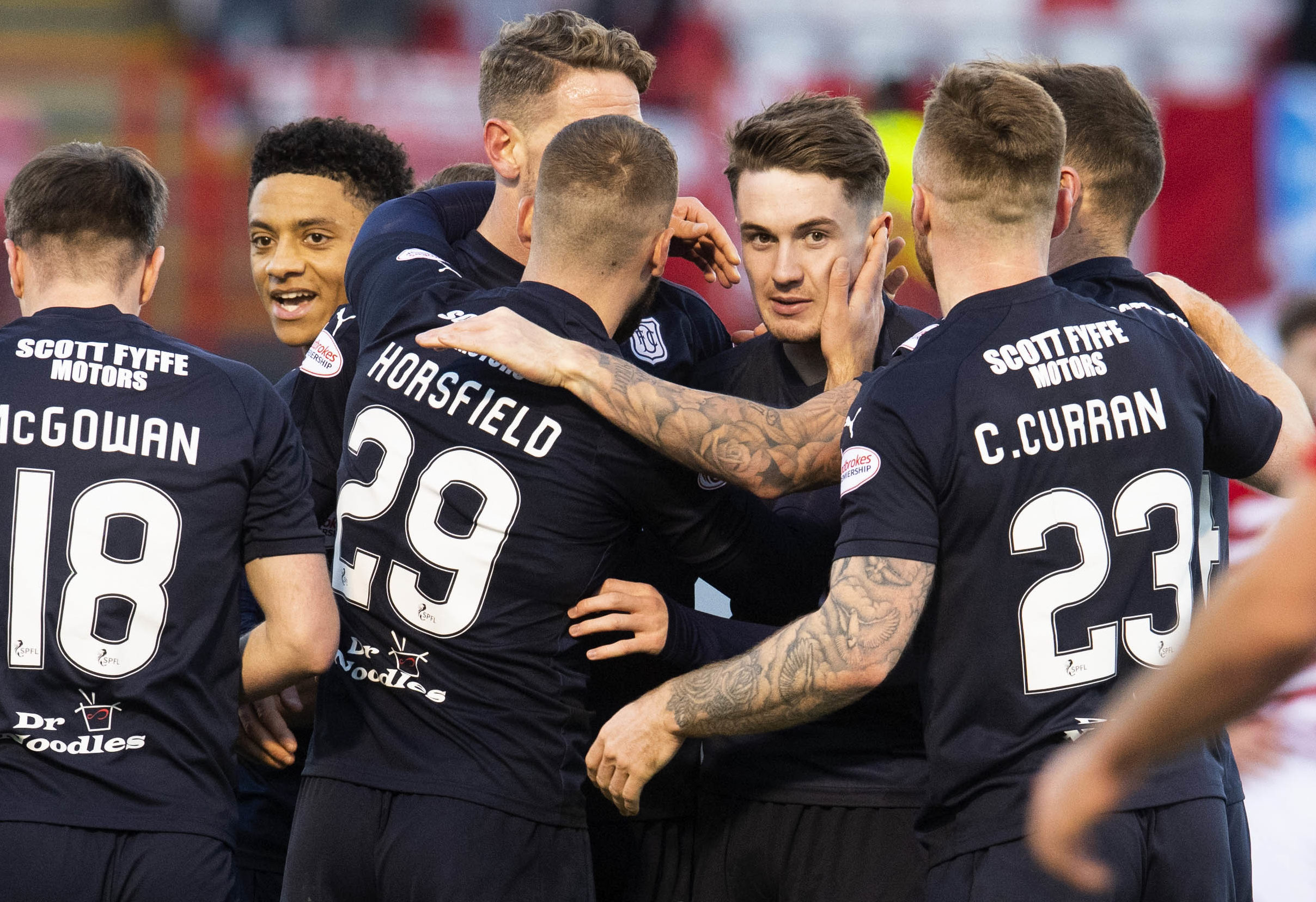 Scott Wright celebrates after scoring for Dundee.