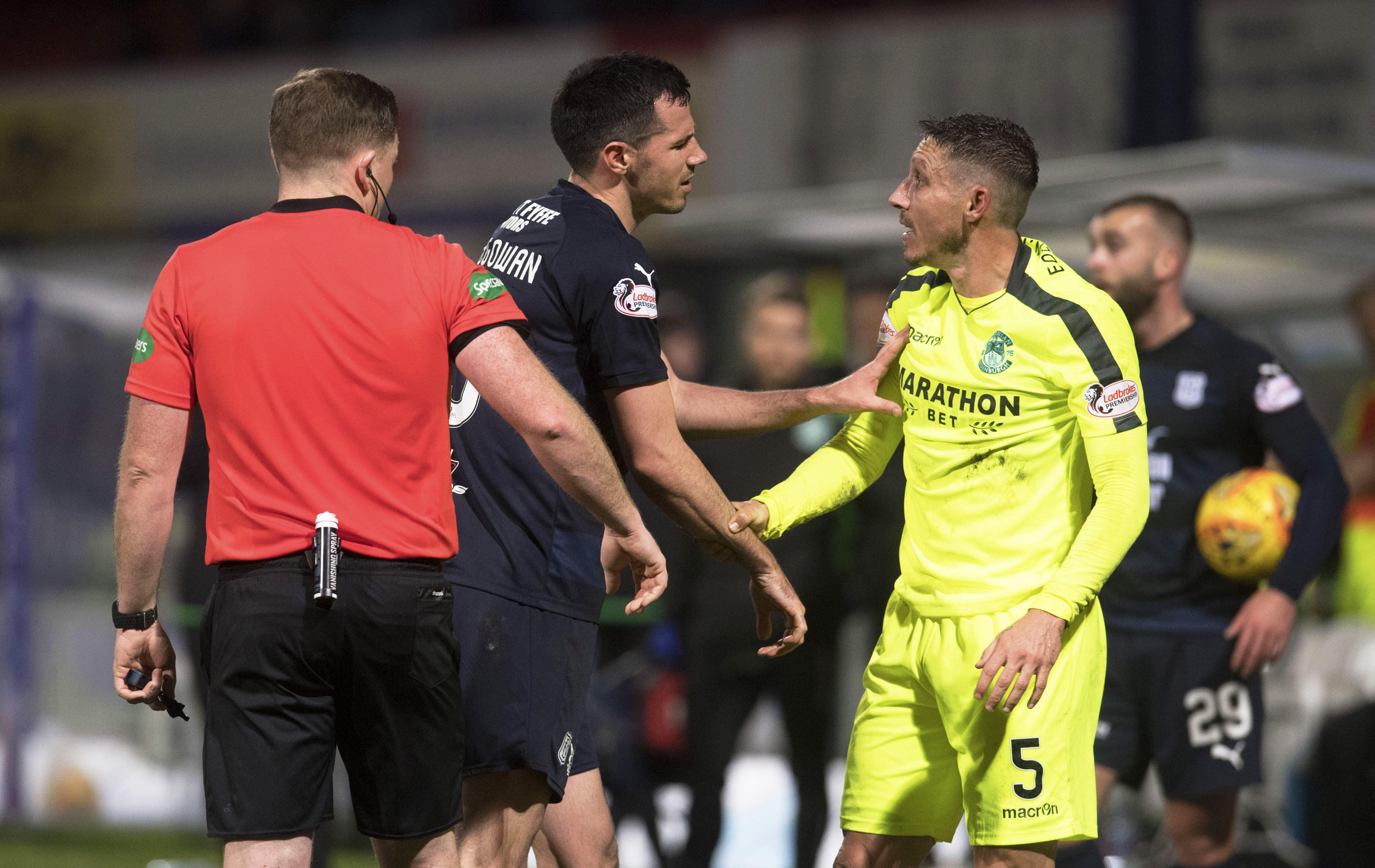 Dundee's Ryan McGowan exchanges words with Hibernian's Mark Milligan.