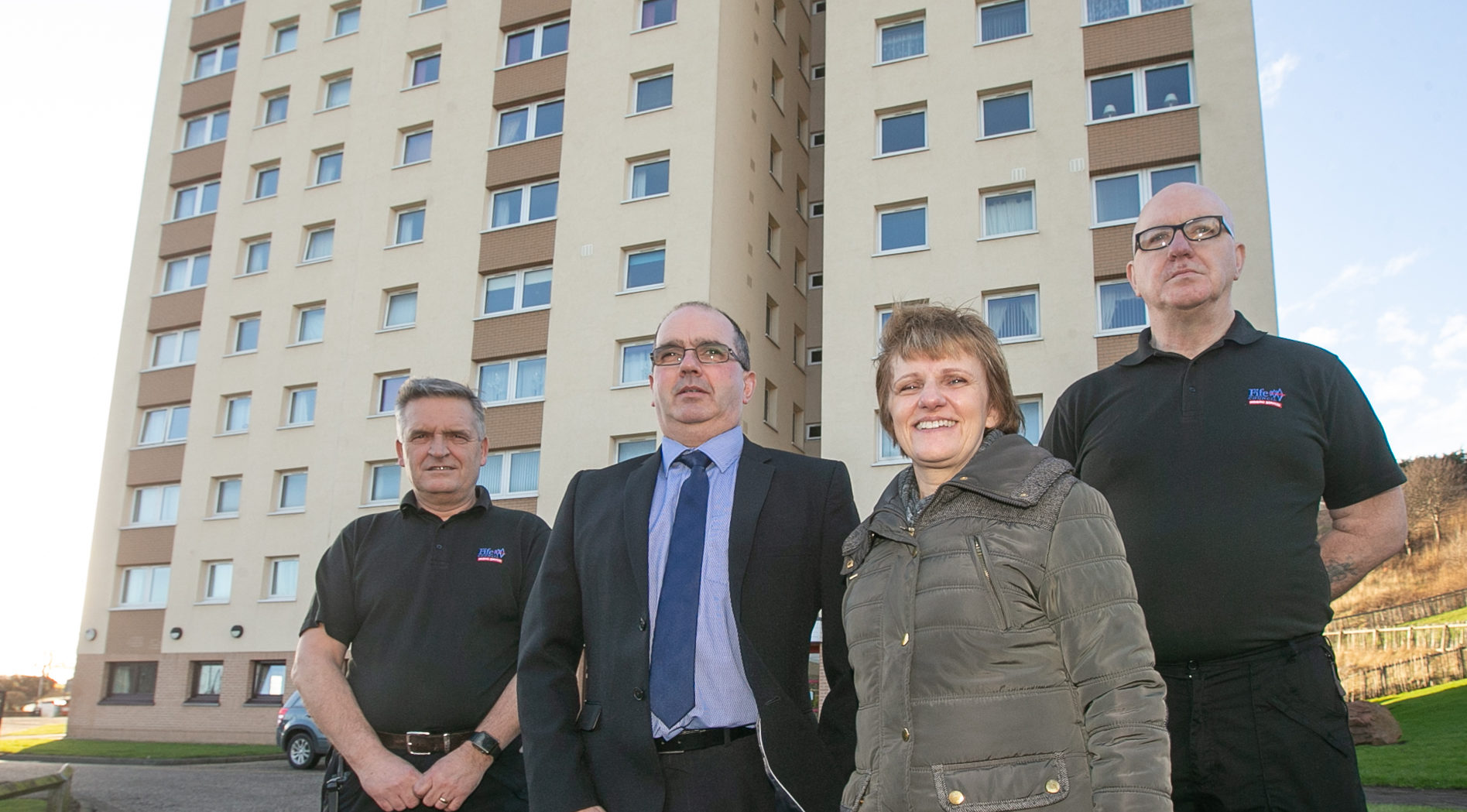 Councillor Judy Hamilton meets up with caretakers at Methil's Swan Court. From left to right Brian Dryburgh, Housing manager Peter Nicol, Mrs Hamilton and Bill Barker