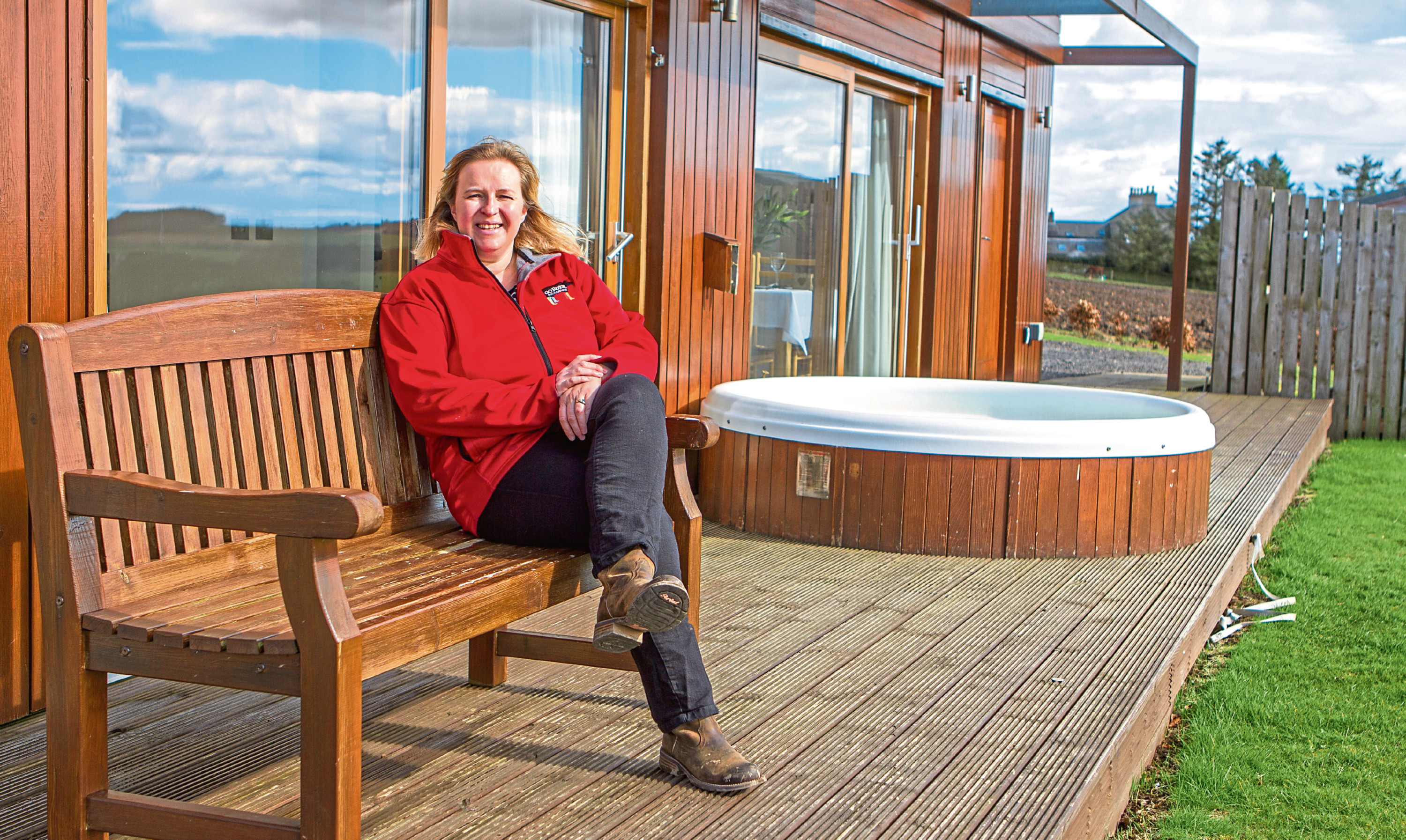 Caroline Milar relaxing at one of The Hideaway Experience luxury lodges she runs.