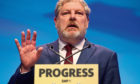 Angus Robertson addresses delegates at the Scottish National Party conference at the SEC Centre in Glasgow. PRESS ASSOCIATION Photo. Picture date: Tuesday October 10, 2017. See PA story POLITICS SNP. Photo credit should read: Jane Barlow/PA Wire