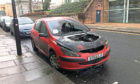 The burned out car in Dundee had a parking ticket on it. However the council say it was not ticketed.