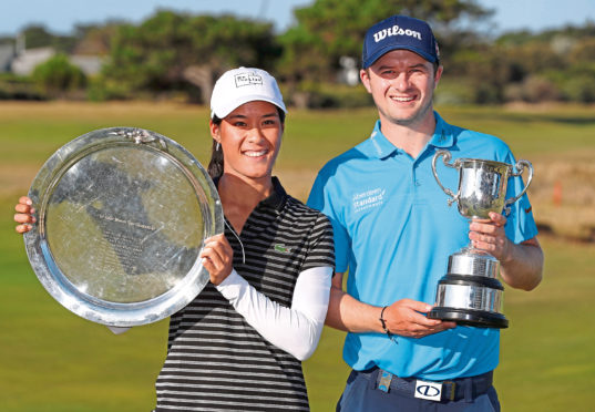 GEELONG, AUSTRALIA - FEBRUARY 10: Celine Boutier of France and David Law of Scotland pose with their winners trophies during day four of the ISPS Handa Vic Open at 13th Beach Golf Club on February 10, 2019 in Geelong, Australia. (Photo by Michael Dodge/Getty Images)