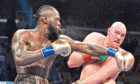 Deontay Wilder and Tyson Fury during the WBC Heavyweight Championship bout at the Staples Center in Los Angeles. Picture: Lionel Hahn/PA Wire
