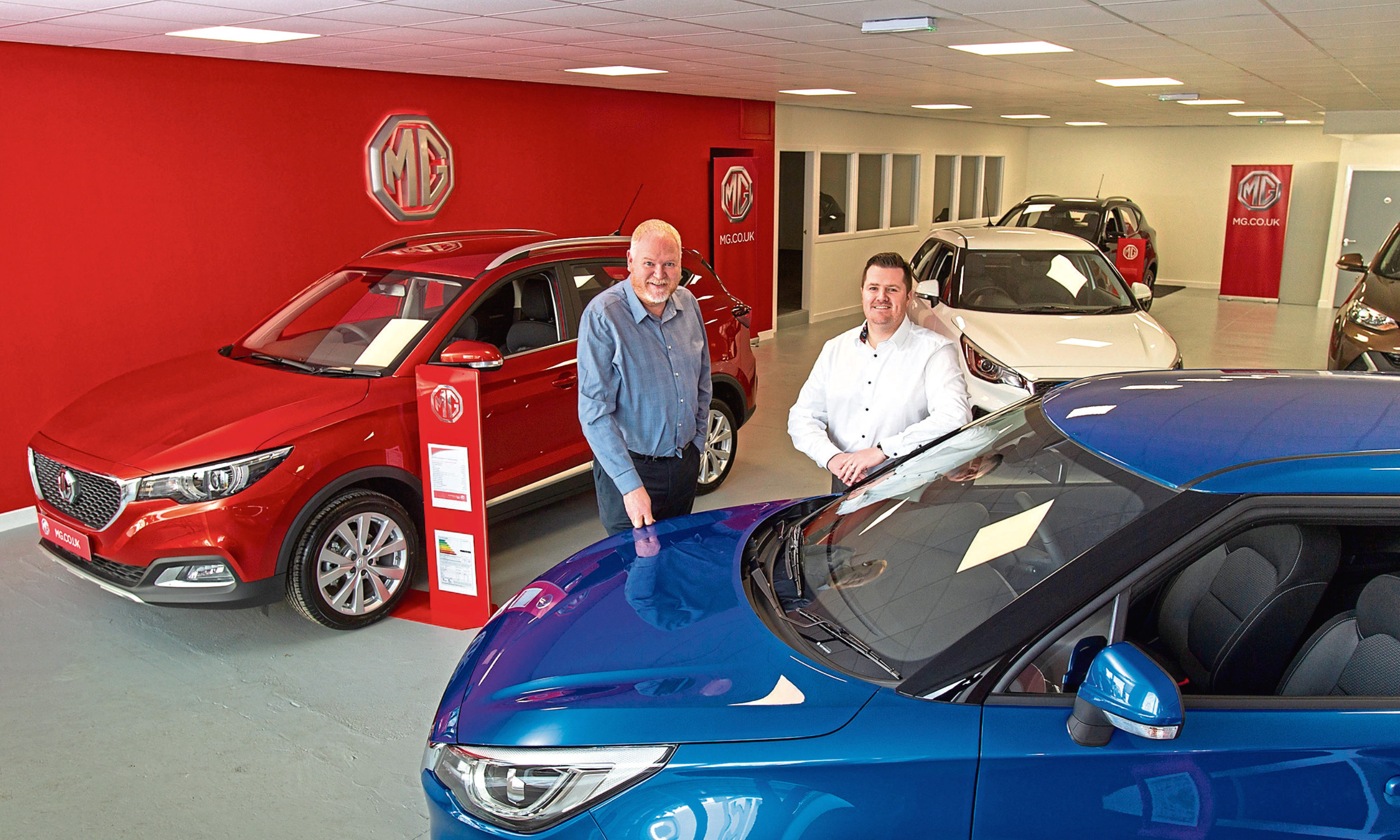 CR0006028  Mackie Motors, Clerk Street, Brechin  Mackie Motors who are opening a new MG dealership opposite their current premises.  Pic shows Franchise Director Greg Black(left) with MG Sales Manager Kevin Cameron  Pic Paul Reid