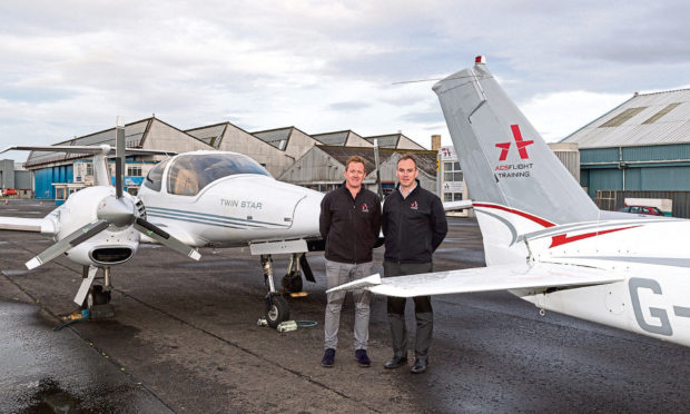 ACS Aviations group technical director Craig McDonald with  managing director Graeme Frater. Picture: Wallace Shackleton