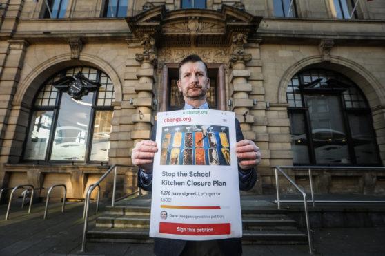 Councillor Dave Doogan with his petition against frozen school meals.