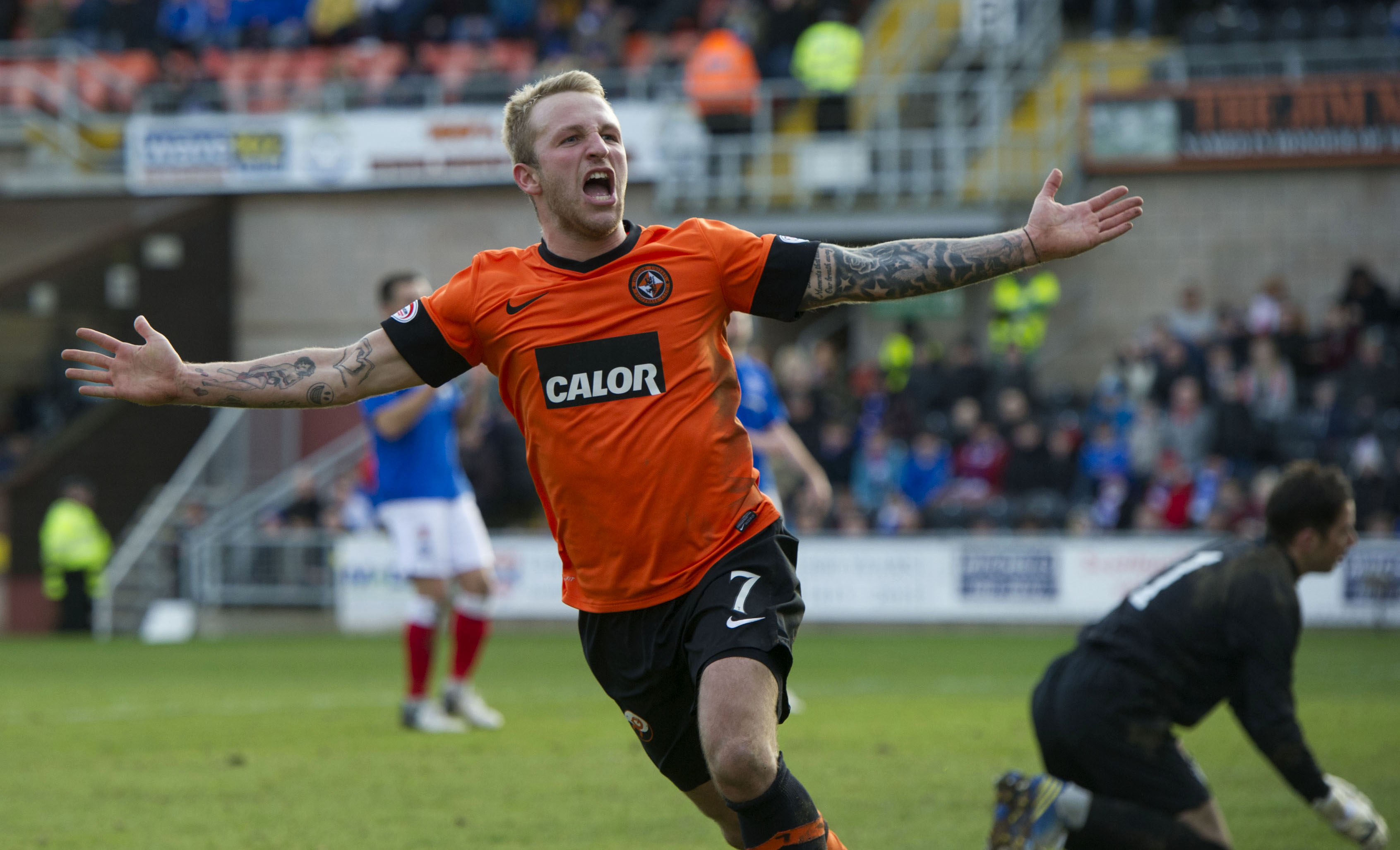 Johnny Russell celebrates a goal in the Scottish Cup against Rangers in 2013.