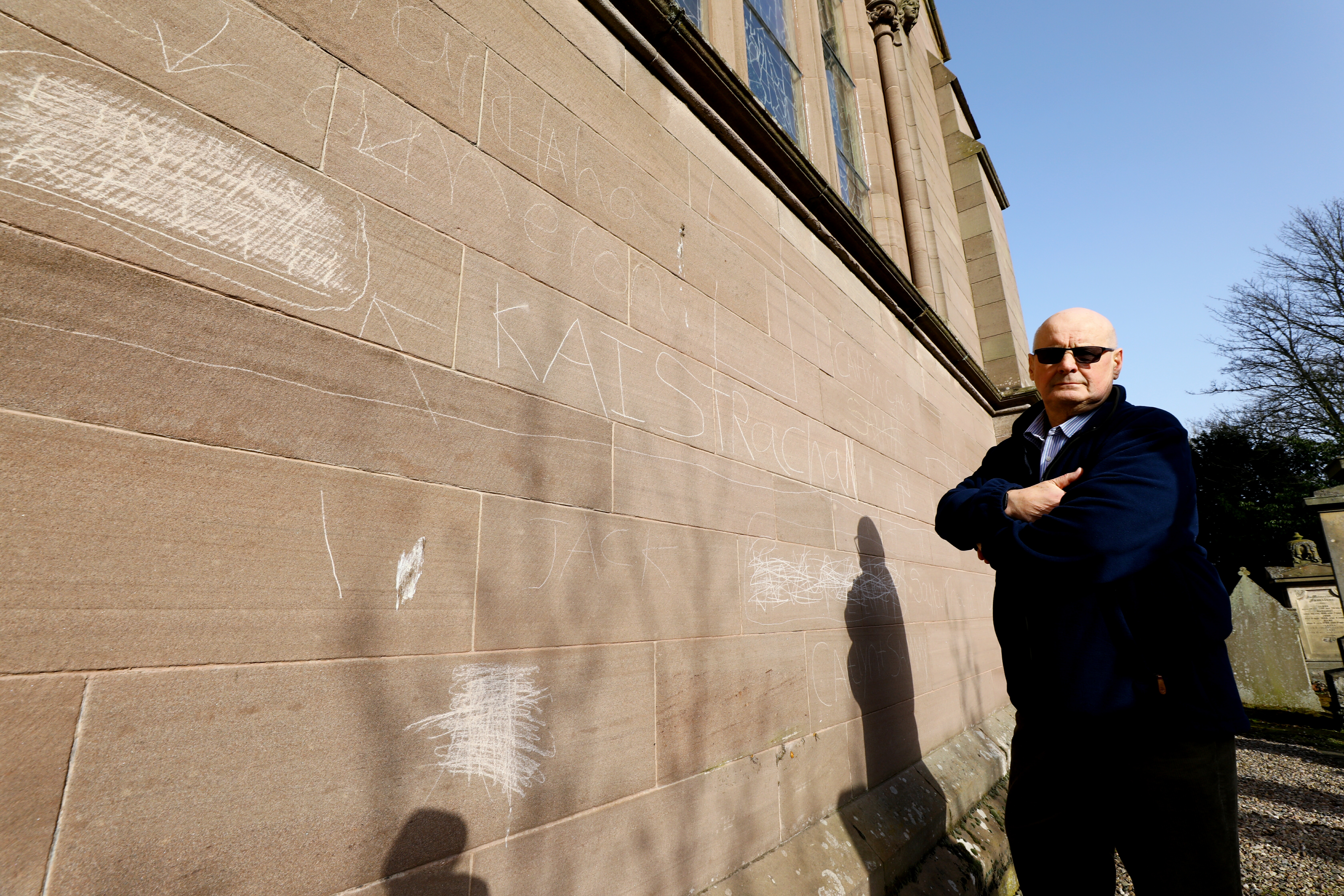 Session clerk Douglas Taylor beside some of the vandalism on Brechin Cathedral following an attack in February.