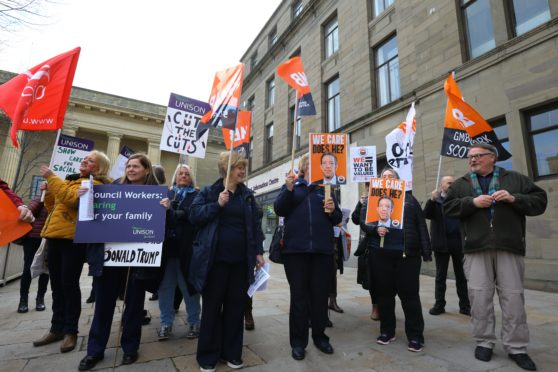 Protests outside Dundee City Chambers ahead of last week's budget meeting.