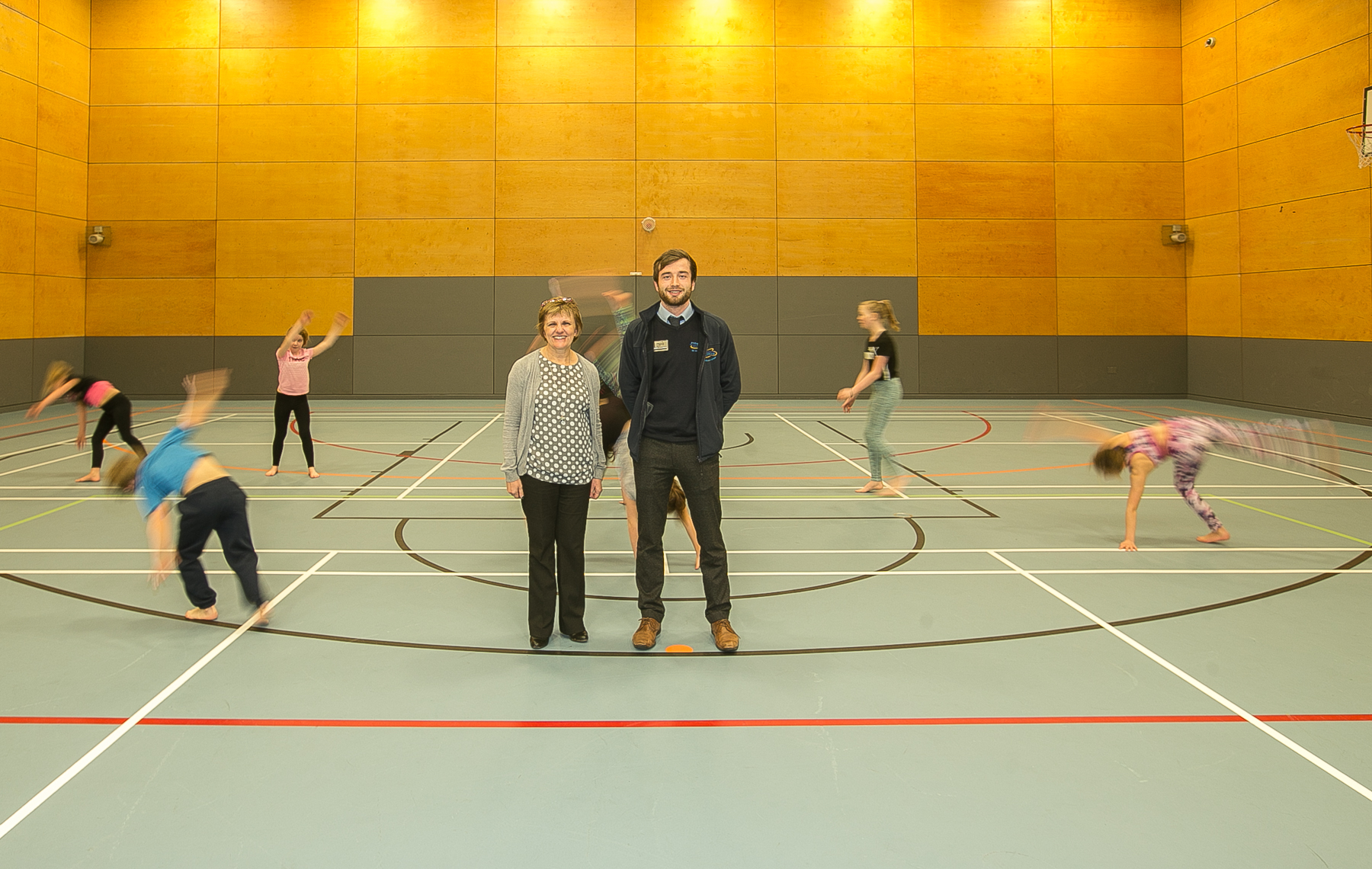 Local gymnasts try out the new sports hall flooring watched on by Cllr Judy Hamilton with Scott Bramall, duty manager, Fire Sports and Leisure Trust.