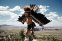 ARIZONA - JUNE 1952: A young Native American boy learns the Eagle Dance in Grand Canyon National Park, Arizona.