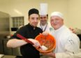 Albert Close with patisserie students Shaun Donovan and James Gilbride mixing melted chocolate to make petits fours.