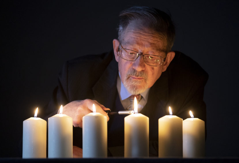 Holocaust survivor Martin Stern lights candles to mark National Holocaust Memorial Day ahead of a Holocaust and genocide survivors event at the Eastwood Park Theatre in Giffnock, East Renfrewshire.